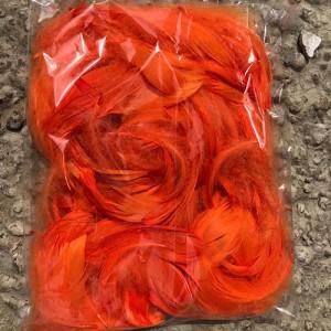 Конфетти для шариков перья декоративные оранжевые 70 гр.